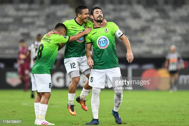 Pedro Ramírez, Ignacio González and Mayker González of Zamora celebrate their second goal during a match between Atletico MG and Zamora as part of...