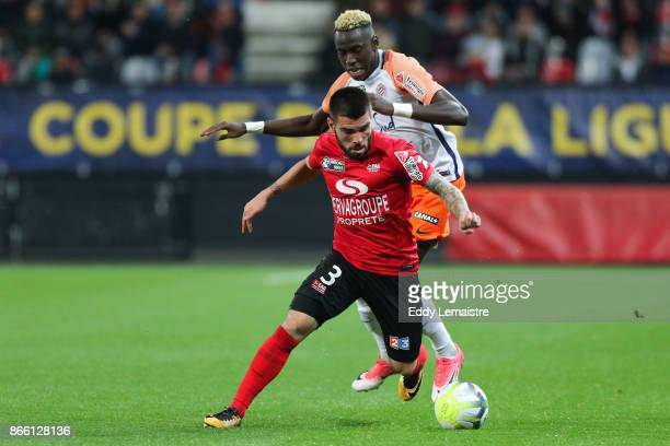 Pedro Rebocho of of Guingamp and Junior Sambia of Montpellier during the French League Cup match between EA Guingamp and Montpellier Herault SC on...