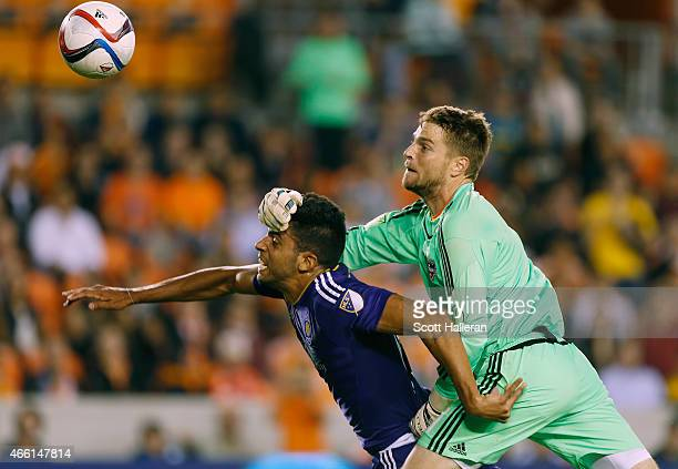 Pedro Ribeiro of Orlando City SC scores a second half goal past Tyler Deric of the Houston Dynamo during their game at BBVA Compass Stadium on March...