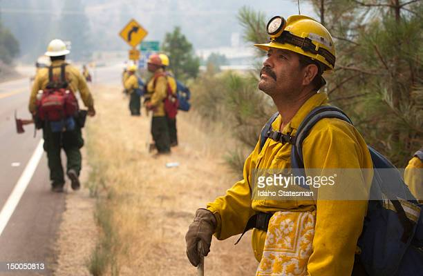 Pedro Rico with the Lava River crew from Oregon keeps an eye on a back burn on the Springs Fire in Idaho near the intersection of Idaho 55 and the...