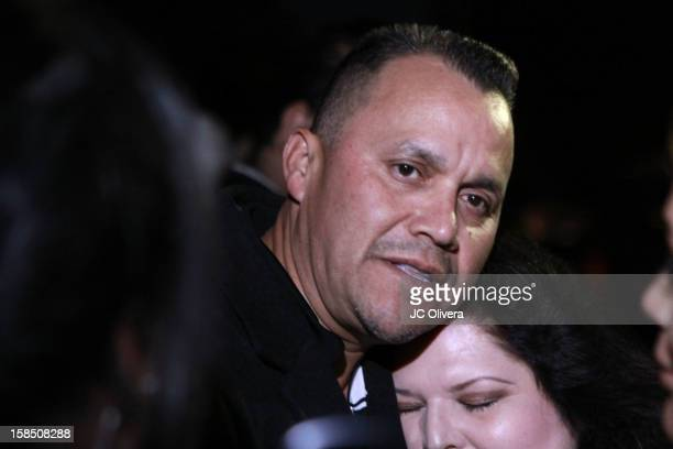 Pedro Rivera JR brother of the late singer Jenni Rivera hugs a fan outside the residence of Rosa Saavedra mother of the singer Jenni Rivera who died...