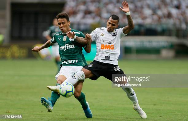 Pedro Rocha of Palmeiras vies the ball with Otero of Atletico MG during a match between Palmeiras and Atletico MG for the Brasileirao Series A 2019...