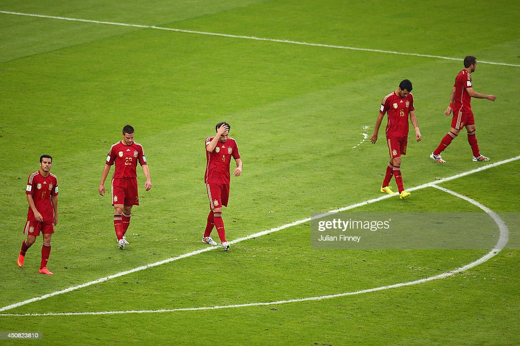 Pedro Rodriguez, Cesar Azpilicueta, Javi Martinez, Sergio Ramos and Jordi Alba of Spain react after giving up Chile's second goal during the 2014 FIFA World Cup Brazil Group B match between Spain and Chile at Maracana on June 18, 2014 in Rio de Janeiro, Brazil.