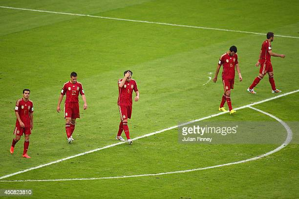 Pedro Rodriguez Cesar Azpilicueta Javi Martinez Sergio Ramos and Jordi Alba of Spain react after giving up Chile's second goal during the 2014 FIFA...