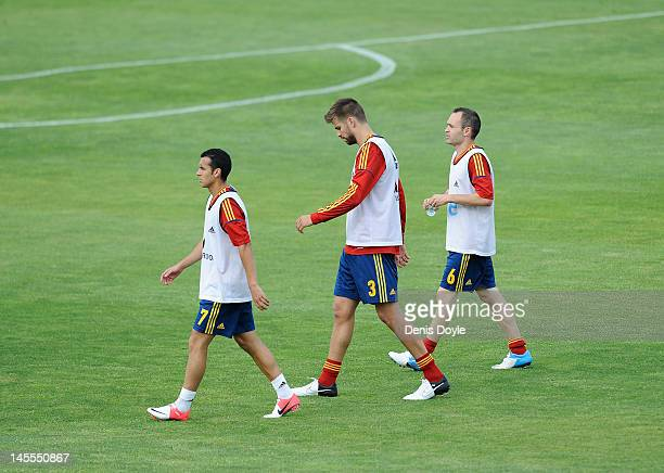 Pedro Rodriguez Gerard Pique and Andres Iniesta walk away after a Spanish team training session for the upcoming Euro 2012 on June 1 2012 in Las...