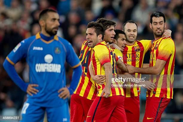 Pedro Rodriguez Ledesma of Barcelona celebrates scoring their second goal with teammates Jordi Alba Sergi Roberto Andres Iniesta and Sergio Busquets...