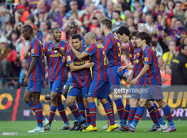 Pedro Rodriguez of Barcelona celebrates with teammates after Barcelona scored their first goal during the La Liga match between Barcelona and Real...