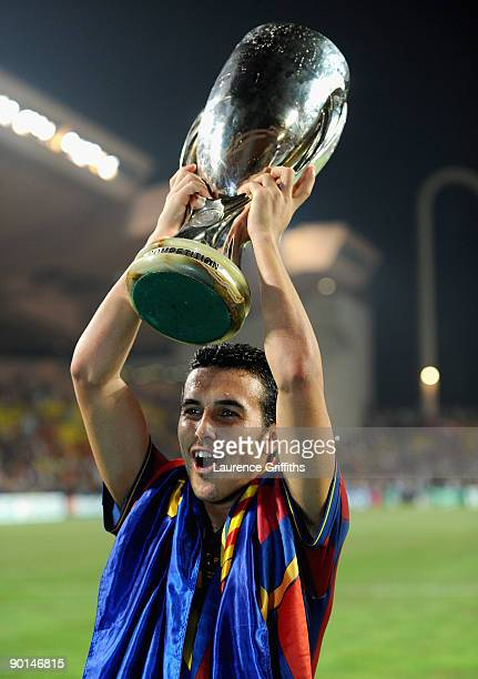 Pedro Rodriguez of Barcelona celebrates with the trophy after defeating the Shakhtar Donetsk at the UEFA Super Cup Final at the Stade Louis II on...