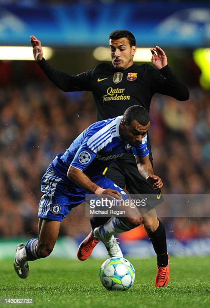 Pedro Rodriguez of Barcelona challenges Ashley Cole of Chelsea during the UEFA Champions League Semi Final first leg match between Chelsea and...