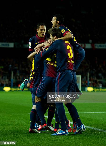 Pedro Rodriguez of Barcelona jumps on top of his teammates celebrating Sergio Busquets scoring a goal during the la Liga match between FC Barcelona...