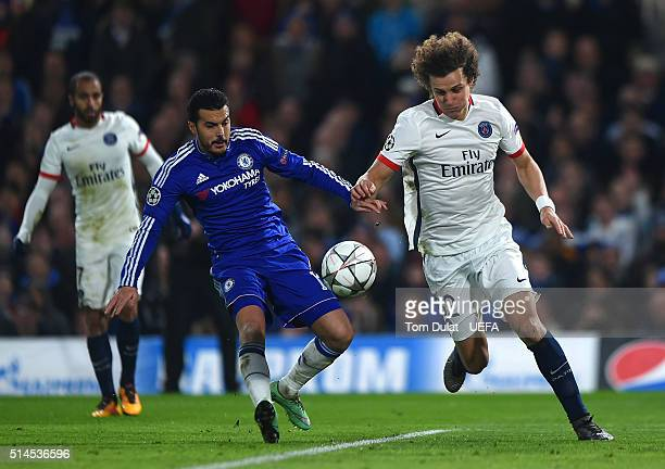 Pedro Rodriguez of Chelsea and David Luiz of Paris SaintGermain in action during the UEFA Champions League round of 16 second leg match between...