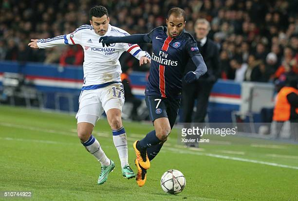 Pedro Rodriguez of Chelsea FC in action with Lucas Moura of Paris SaintGermain during the UEFA Champions League round of 16 between Paris...