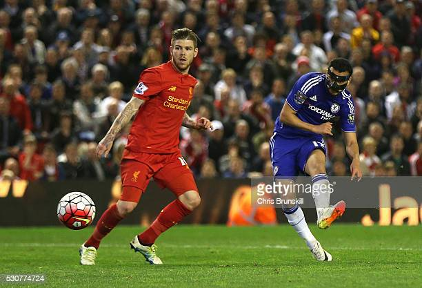 Pedro Rodriguez of Chelsea takes a shot on goal during the Barclays Premier League match between Liverpool and Chelsea at Anfield on May 11 2016 in...