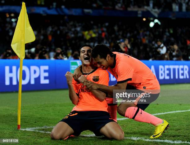 Pedro Rodriguez of FC Barcelona celebrates scoring his side's 89th minute equalizing goal with teammate Jeffren Suarez during the FIFA Club World Cup...