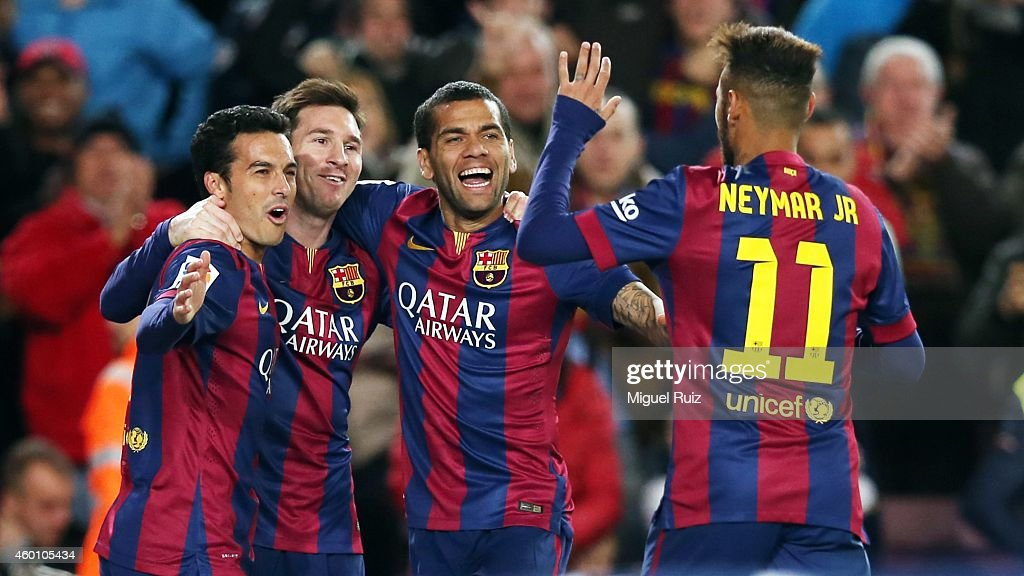 Pedro Rodriguez of FC Barcelona celebrates the fourth goal with his team-mates Lionel Messi, Dani Alves and Neymar during the La Liga match between FC Barcelona and RCD Espanyol at Camp Nou on December 7, 2014 in Barcelona, Spain.
