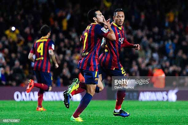 Pedro Rodriguez of FC Barcelona celebrates with his teammate Adriano Correia after scoring his team's first goal during the La Liga match between FC...