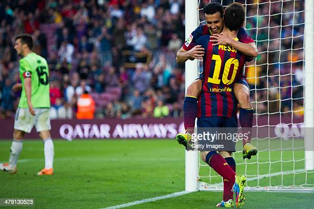 Pedro Rodriguez of FC Barcelona celebrates with his teammate Lionel Messi after scoring his team's seventh goal during the La Liga match between FC...