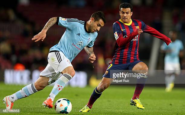 Pedro Rodriguez of FC Barcelona competes for the ball with Hugo Mallo of RC Celta during La Liga match 30 between FC Barcelona and RC Celta at Nou...