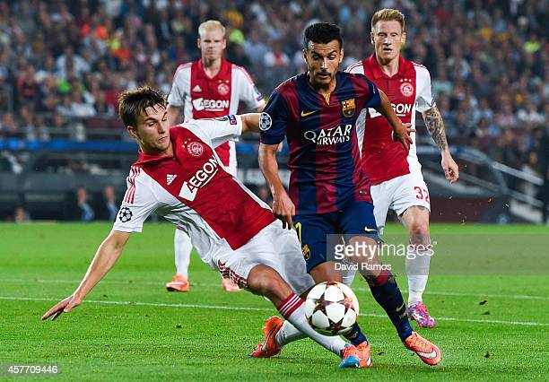 Pedro Rodriguez of FC Barcelona competes for the ball with Joel Veltman of AFC Ajax during a UEFA Champions League Group F match between FC Barcelona...