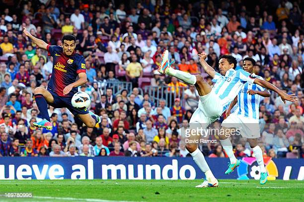 Pedro Rodriguez of FC Barcelona duels for the ball with Weligton de Oliveira of Malaga CF during the La Liga match between FC Barcelona and Malaga CF...