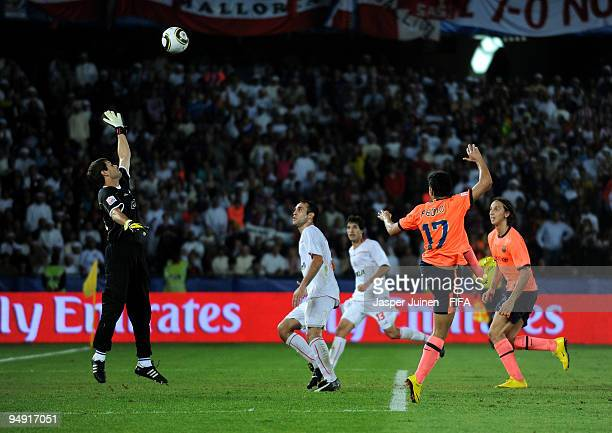 Pedro Rodriguez of FC Barcelona heads in his sides last minute equalizing goal past goalkeeper Damian Albil of Estudiantes during the FIFA Club World...