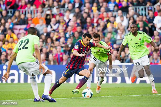 Pedro Rodriguez of FC Barcelona plays the ball alongside Jordan Loties Oier Sanjurjo and Raoul Cedric Loe of CA Osasuna during the La Liga match...