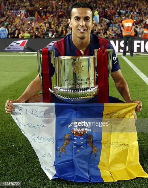 Pedro Rodriguez of FC Barcelona poses with the Copa del Rey trophy after winning the Copa del Rey Final between Athletic Club and FC Barcelona at...