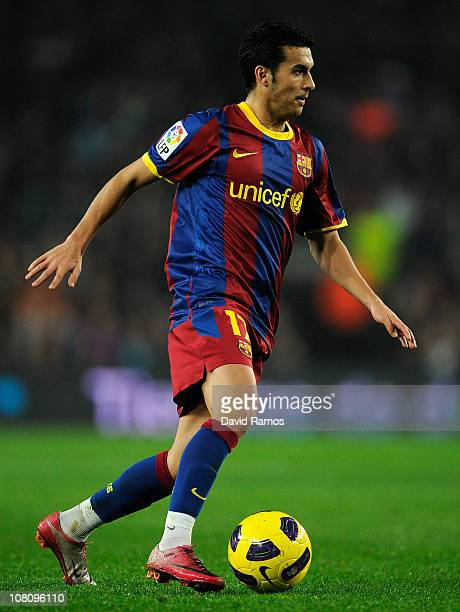 Pedro Rodriguez of FC Barcelona runs with the ball during the La Liga match between FC Barcelona and Malaga at Nou Camp on January 16 2011 in...