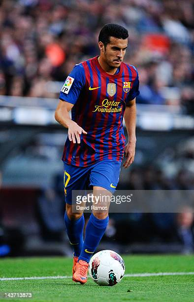 Pedro Rodriguez of FC Barcelona runs with the ball during the La Liga match between FC Barcelona and Malaga CF at Camp Nou Stadium on May 2 2012 in...