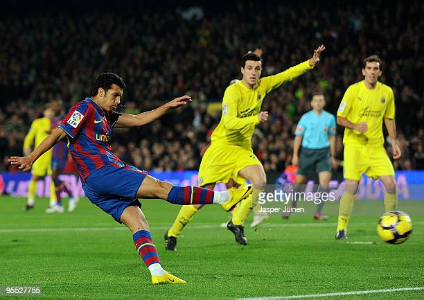 Pedro Rodriguez of FC Barcelona scores his sides opening goal during the La Liga match between Barcelona and Villarreal at the Camp Nou Stadium on...