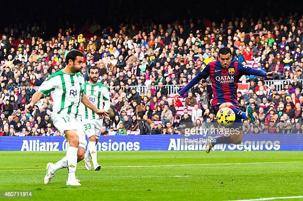 Pedro Rodriguez of FC Barcelona scores the opening goal during the La Liga match between FC Barcelona and Cordoba CF at Camp Nou on December 20 2014...