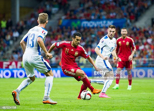 Pedro Rodriguez of Spain duels for the ball with Patrik Hrosovsky of Slovakia during the Spain v Slovakia EURO 2016 Qualifier at Carlos Tartiere on...
