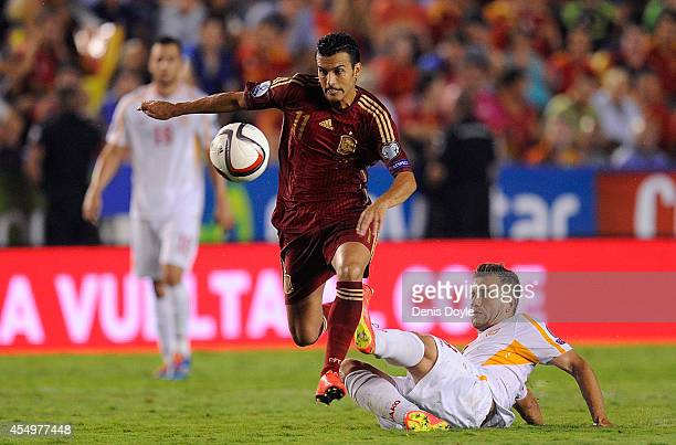 Pedro Rodriguez of Spain gets past Muhamed Demiri of FYR of Macedonia during the UEFA EURO 2016 Group C Qualifier between Spain and FYR of Macedonia...