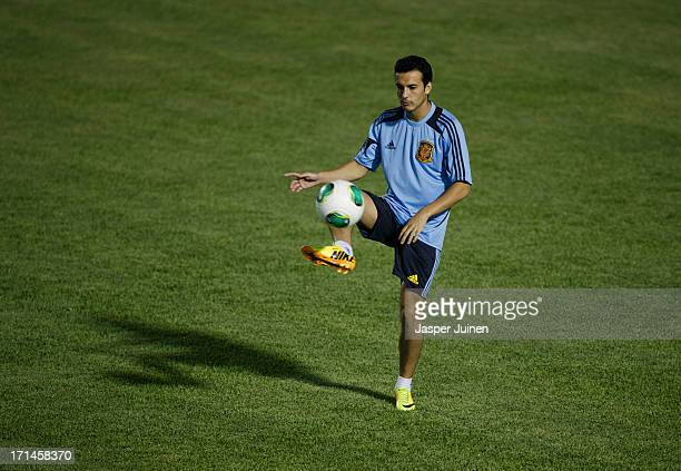 Pedro Rodriguez of Spain juggles the ball during a training session ahead of their FIFA Confederations Cup Brazil 2013 semi final game against Italy...