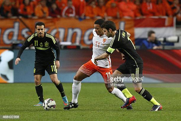 Pedro Rodriguez of Spain Memphis Depay of Holland Francesc Fabregas of Spain during the International friendly match between Netherlands and Spain on...