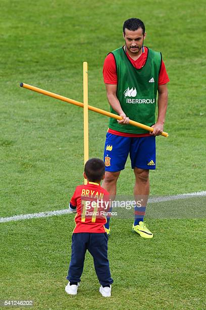 Pedro Rodriguez of Spain plays with his son Bryan Rodriguez during a training session at Complexe Sportif Marcel Gaillard on June 19 2016 in La...