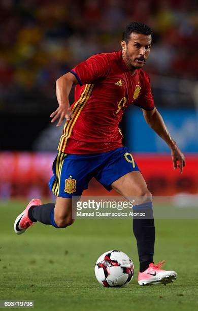 Pedro Rodriguez of Spain runs with the ball during the international friendly match between Spain and Colombia at Nueva Condomina Stadium on June 7...