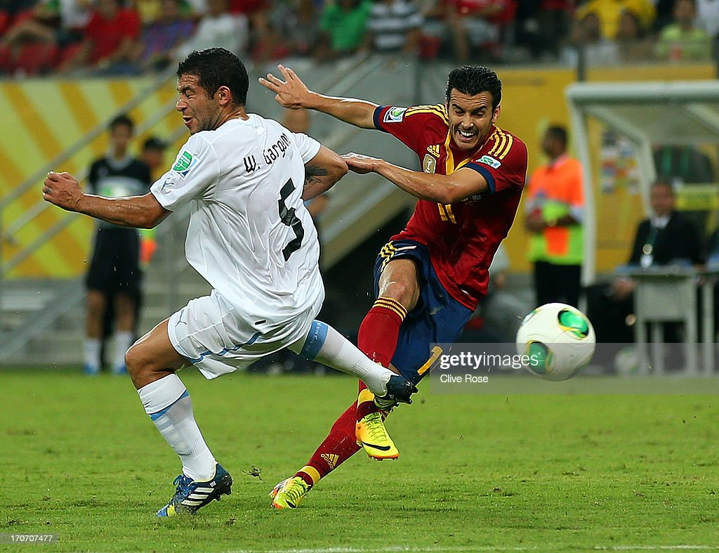 Pedro Rodriguez of Spain scores their first goal during the FIFA Confederations Cup Brazil 2013 Group B match between Spain and Uruguay at the Arena Pernambuco on June 16, 2013 in Recife, Brazil.