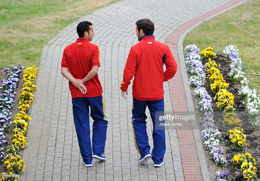 Pedro Rodriguez (L) of Spain walks alongside his teammate Juan Mata after attending a press conference ahead of UEFA EURO 2012 on June 7, 2012 in Gniewino, Poland.