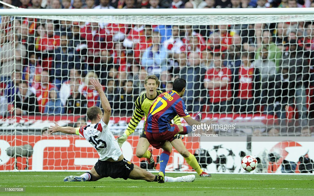 Pedro Rodriquez of Barcelona scores the first goal while challenged by Nemanja Vidic (L) of Manchester United during the UEFA Champions League final between FC Barcelona and Manchester United FC at Wembley Stadium on May 28, 2011 in London, England. Barcelona won the match 3-1.