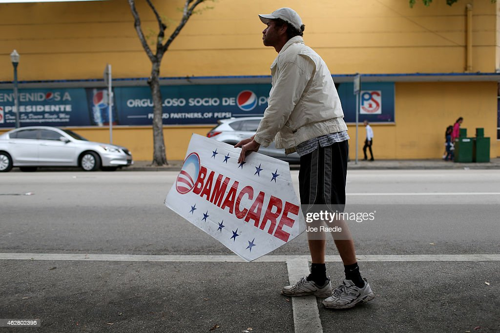 Pedro Rojas holds a sign directing people to an insurance company where they can sign up for the Affordable Care Act, also known as Obamacare, before the February 15th deadline on February 5, 2015 in Miami, Florida. Numbers released by the government show that the Miami-Fort Lauderdale-West Palm Beach metropolitan area has signed up 637,514 consumers so far since open enrollment began on Nov. 15, which is more than twice as many as the next large metropolitan area, Atlanta, Georgia.