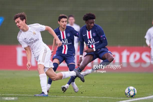 Pedro Ruiz of Real Madrid Kays RuizAtil of Paris SaintGermain and Maxen Kapo of Paris SaintGermain battle for the ball during the match between Real...