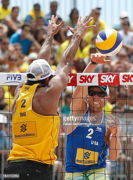 Pedro Salgado of Brazil and Casey Jennings of United States in action during day six of the FIVB Beach Volleyball Sao Paulo Grand Slam 2013 at Parque...