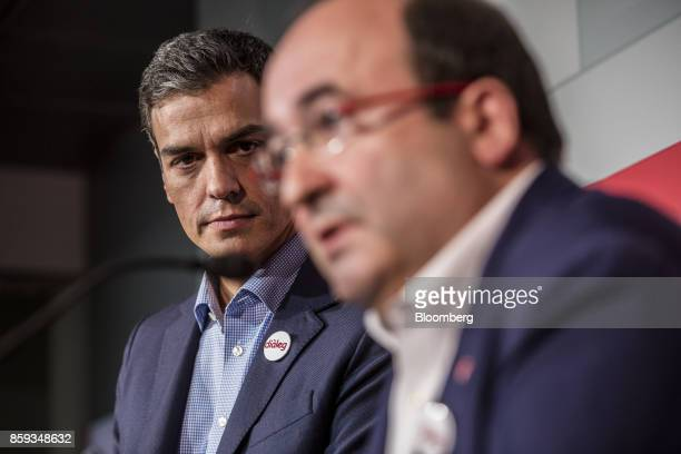 Pedro Sanchez leader of the Spanish Socialist Party left listens as Miquel Iceta first Secretary of Socialists' Party of Catalonia speaks during a...