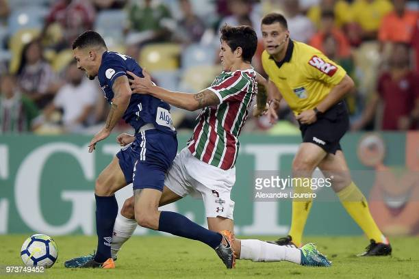 Pedro Santos of Fluminense struggles for the ball with Alison of Santos during the match between Fluminense and Santos as part of Brasileirao Series...