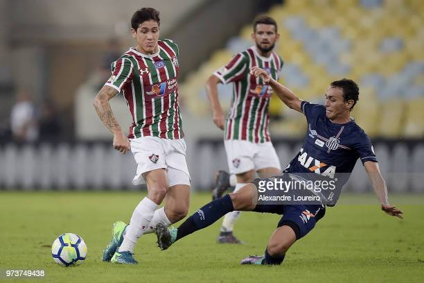 Pedro Santos of Fluminense struggles for the ball with Diego Pituca of Santos during the match between Fluminense and Santos as part of Brasileirao...