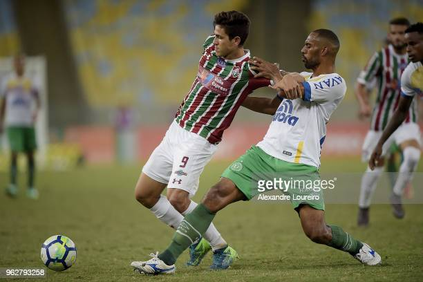 Pedro Santos of Fluminense struggles for the ball with Douglas of Chapecoense during the match between Fluminense and Chapecoense as part of...