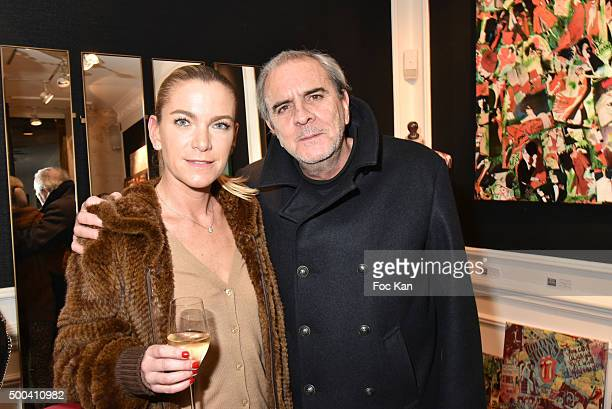 Pedro Serna and his wife Olivia Serna Sulitzer attend the 'Accords Croises' Anne Mondy Exhibition Preview at Galerie Dedar on December 7 2015 in...