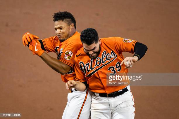 Pedro Severino of the Baltimore Orioles celebrates with Renato Nunez after hitting in the gamewinning run against the Boston Red Sox during the tenth...