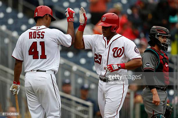 Pedro Severino of the Washington Nationals celebrates with teammate Joe Ross after hitting a solo home run in the third inning against the Arizona...